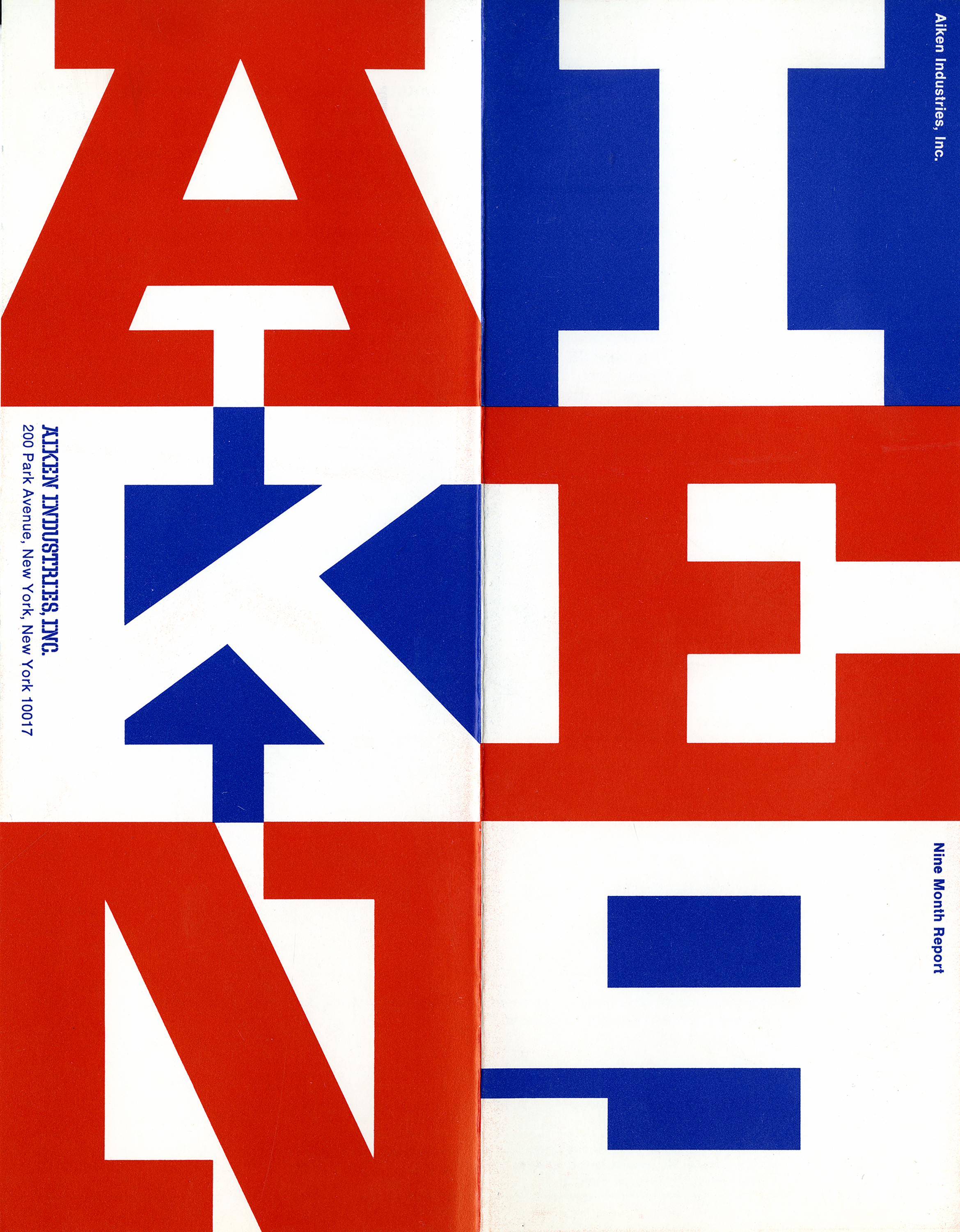 "The word ""AIKEN"" in large block text, taking up the whole of the page in red, white and blue."