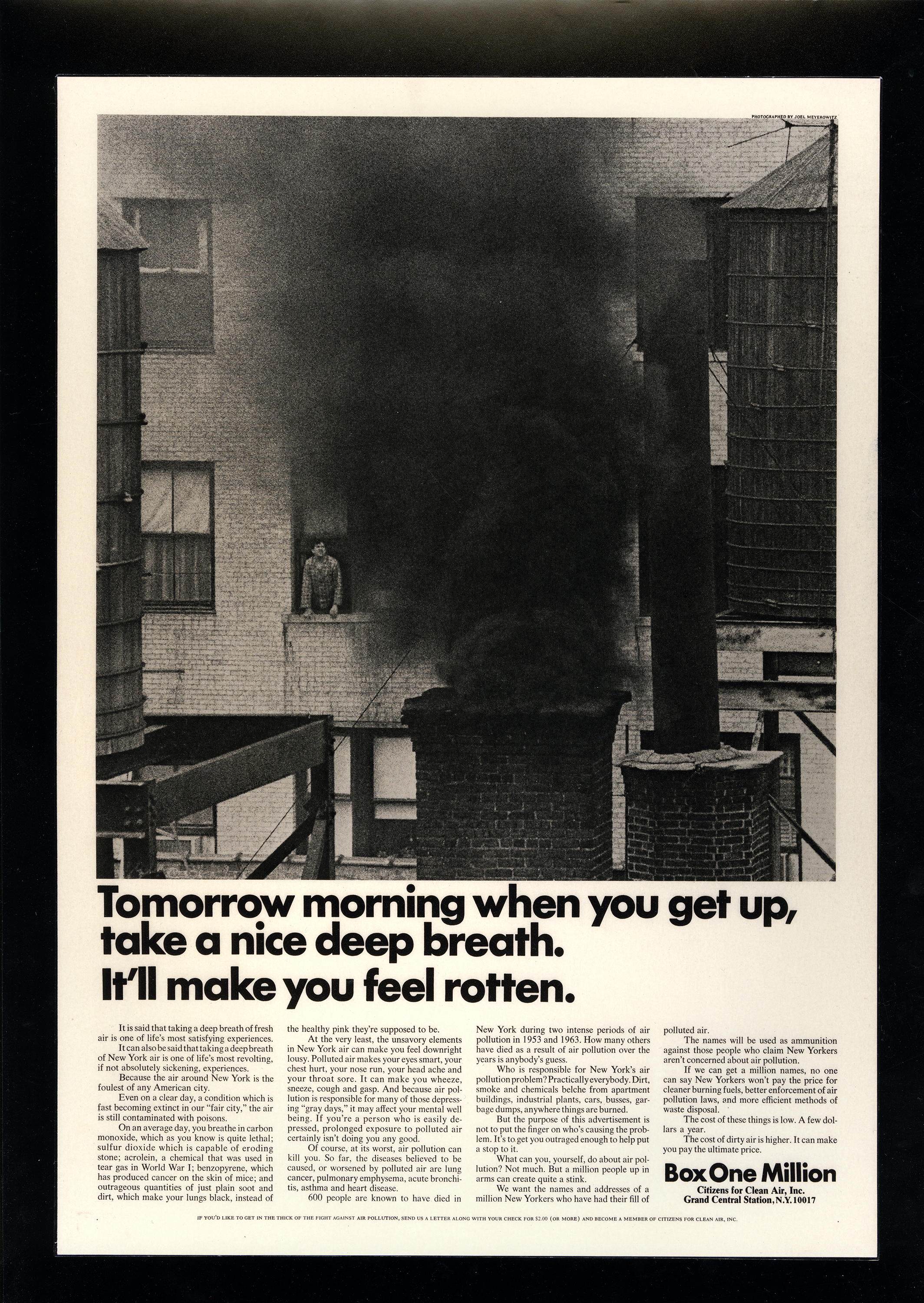 "Black and white photograph of a chimney billowing black smoke and a man in a window observes in disgust, over the title, ""Tomorrow morning when you get up, take a nice deep breath. It will make you feel rotten."""