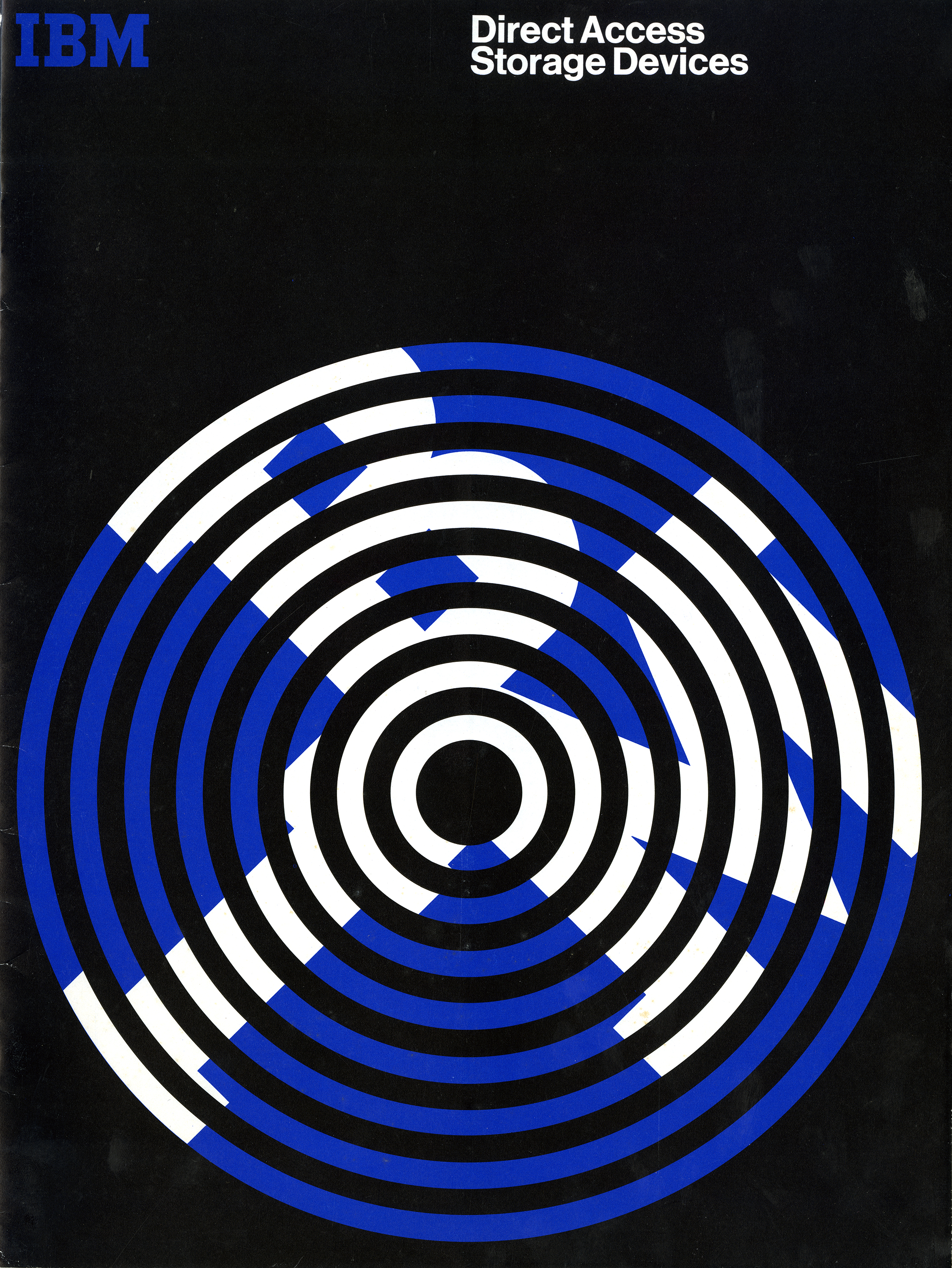 "Booklet cover with blue concentric circles against a black background; the letters ""IBM"" are superimposed onto the blue in white. Text at top right, ""Direct Access Storage Devices"" in white"