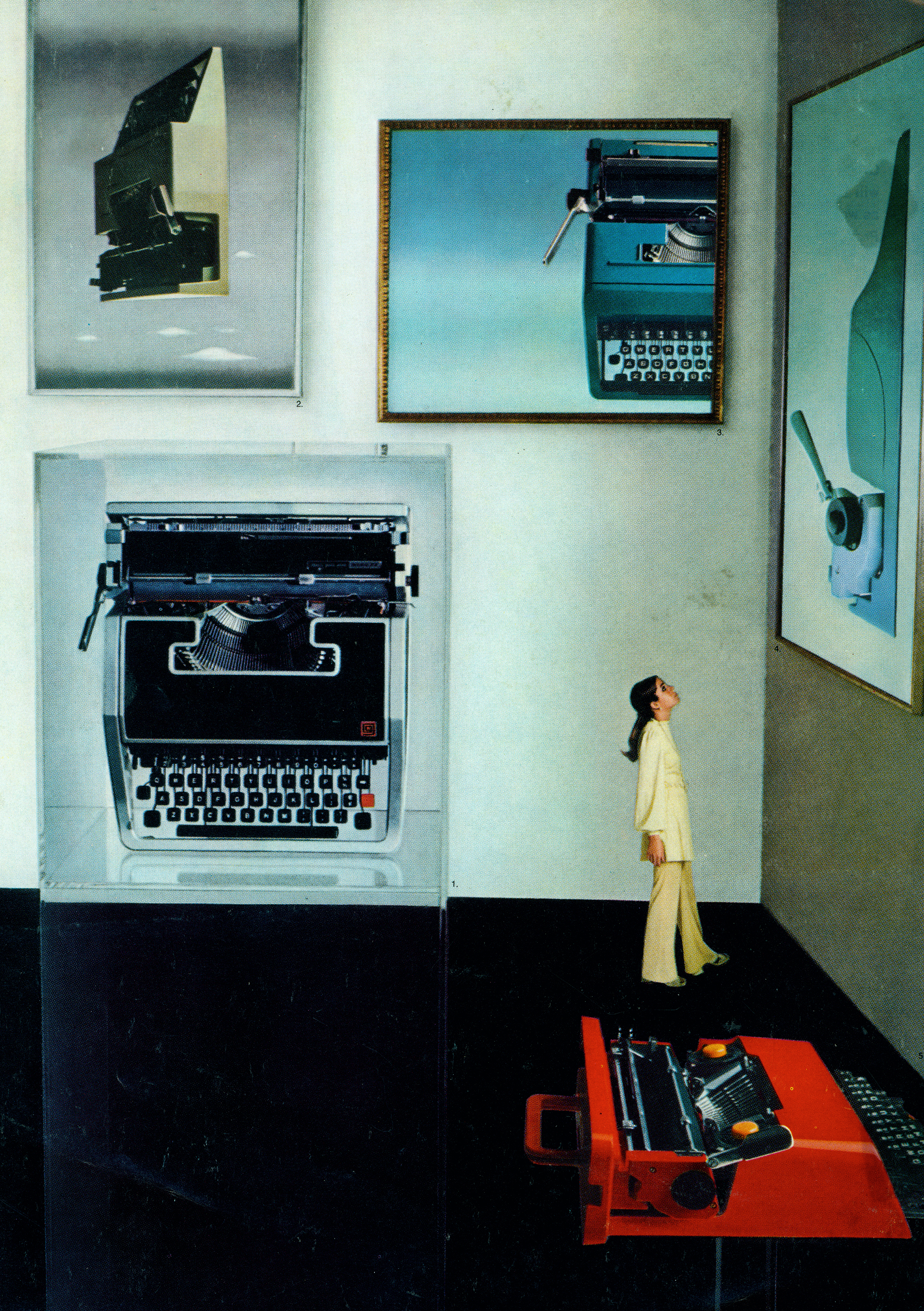 Color photo of a woman looking up at a gallery show; the art is all large photographs of typewriters.