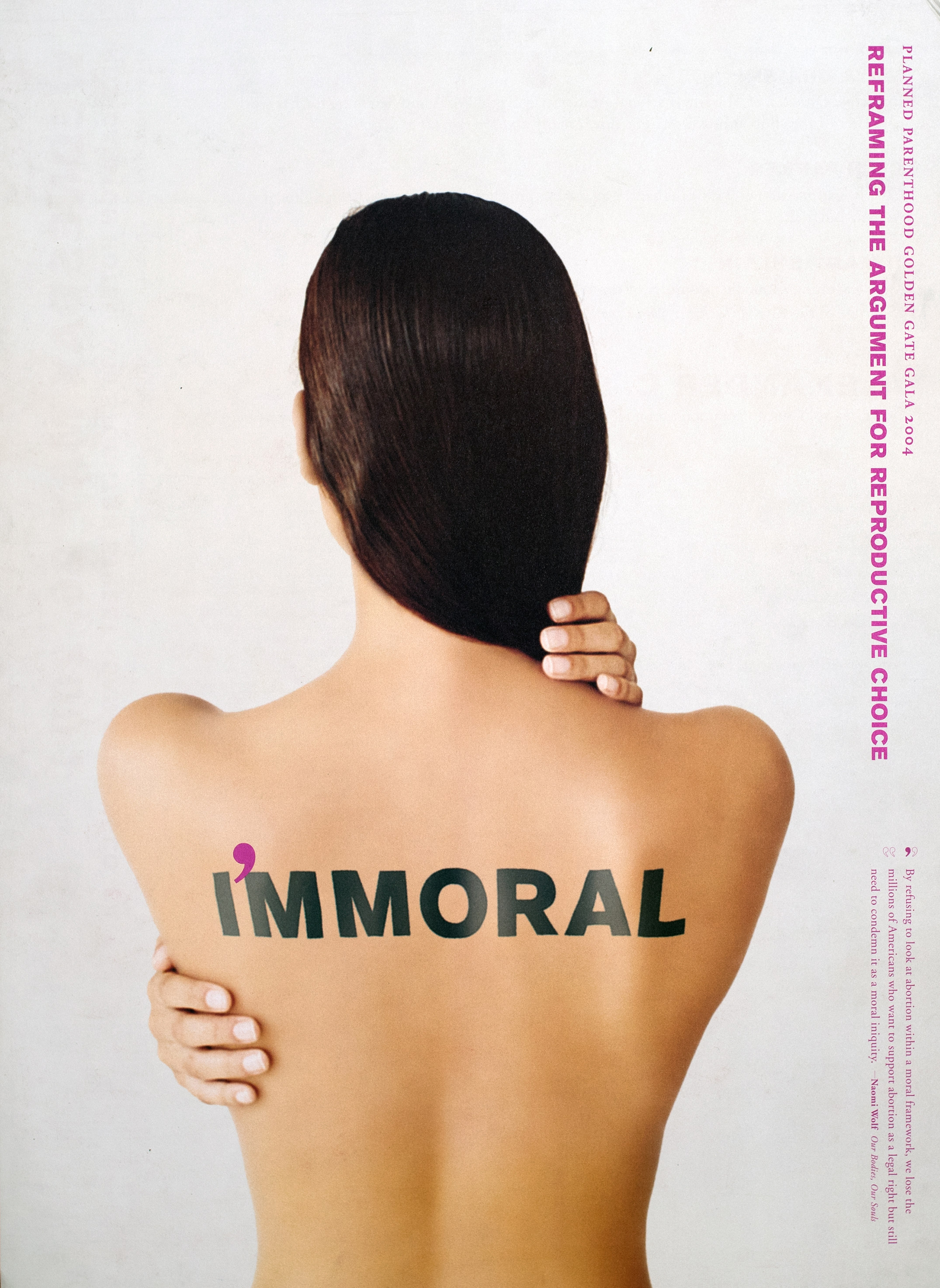 "A photograph of the back of a woman's body from the waist up. The word ""IMMORAL"" is written across her shoulders in black, with a purple apostrophe in between the I and the first M."
