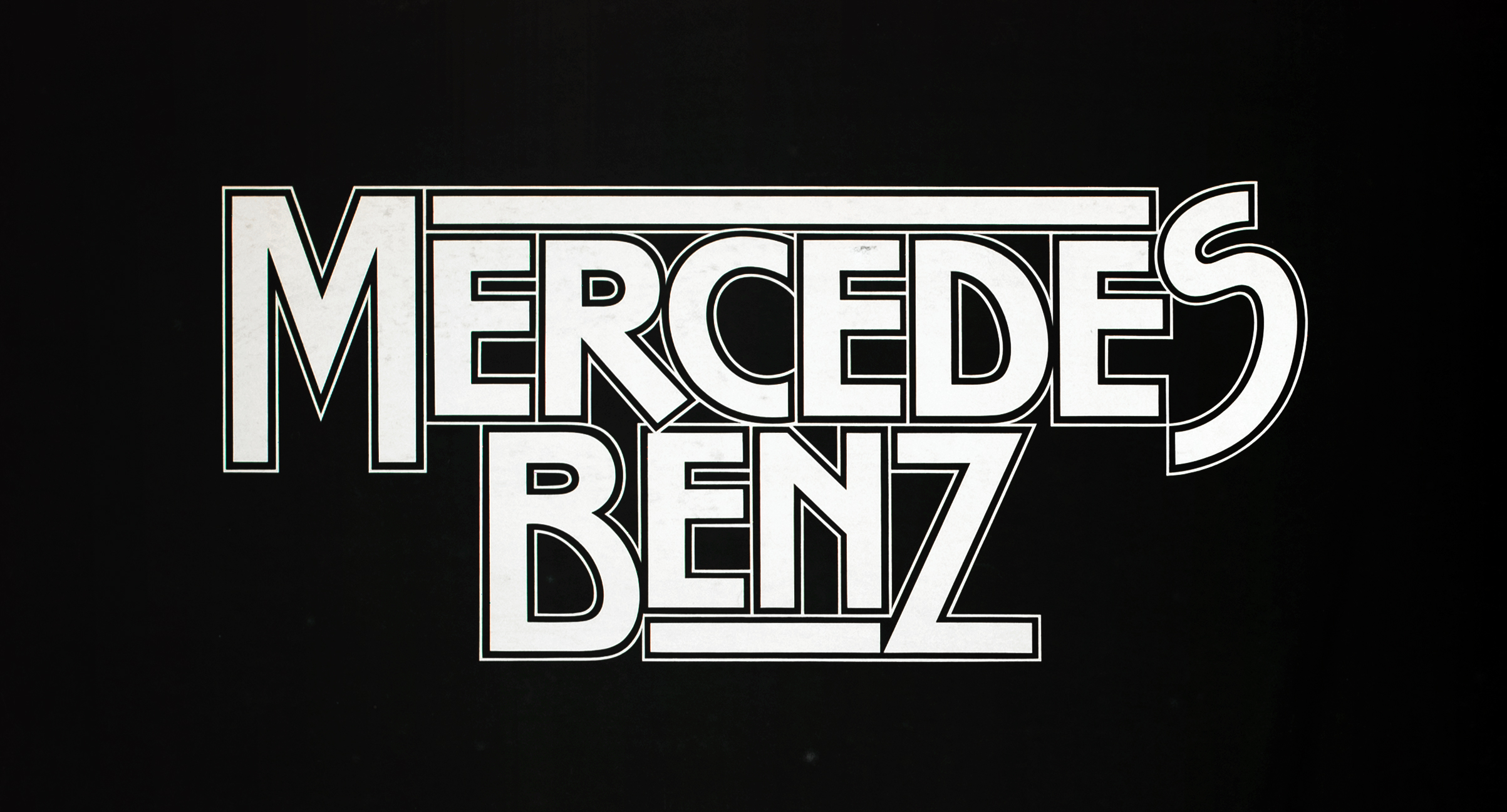 "The words ""Mercedes Benz"" in white against a black background."