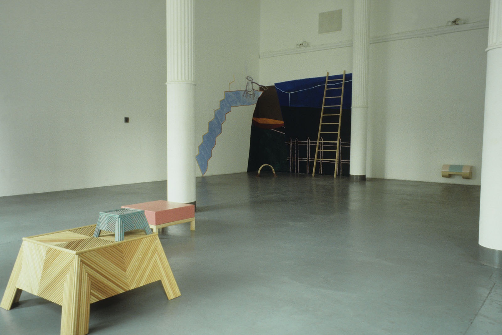 Color photograph of art installations in a gallery.
