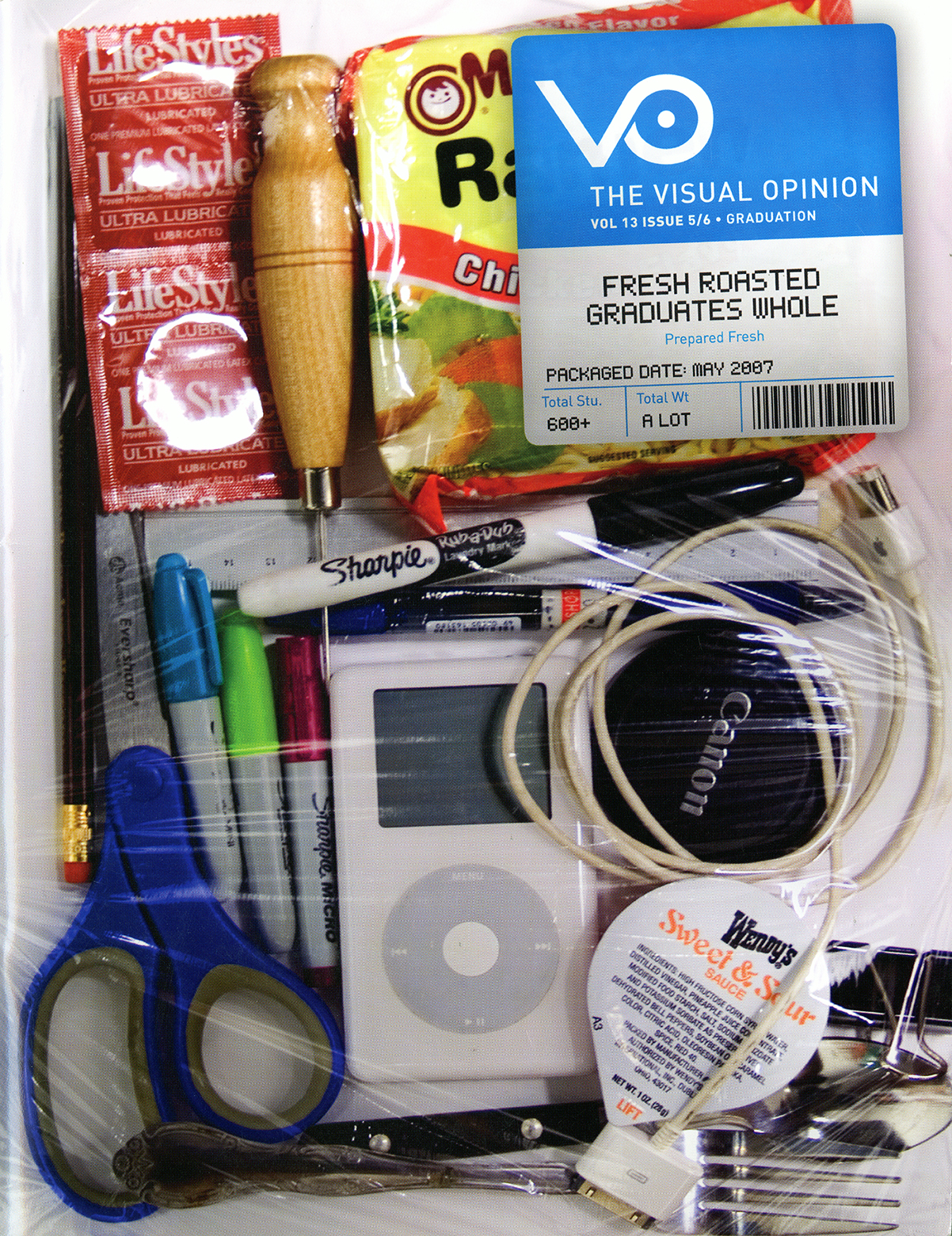Typical recent art-school graduate items (condoms, ramen noodles, art supplies, an iPod, etc.) packaged together in a foam tray like pre-packaged meat.