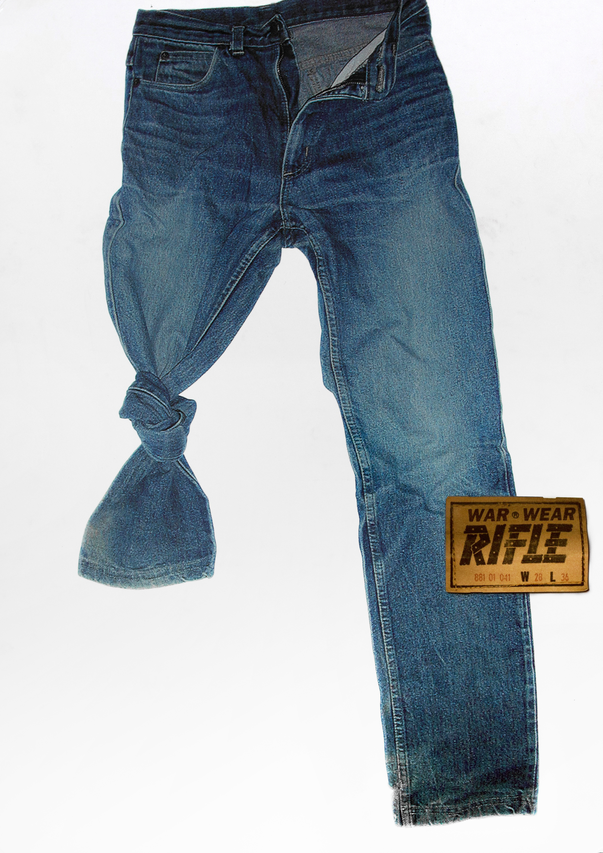 "A photograph of a pair of blue jeans against a white background. One leg is knotted at the knee, implying the intended wearer has lost part of their leg. A large, Levi's-style patch reads, ""War Wear, Rifle, 881 01 041 W 28 L 36."""