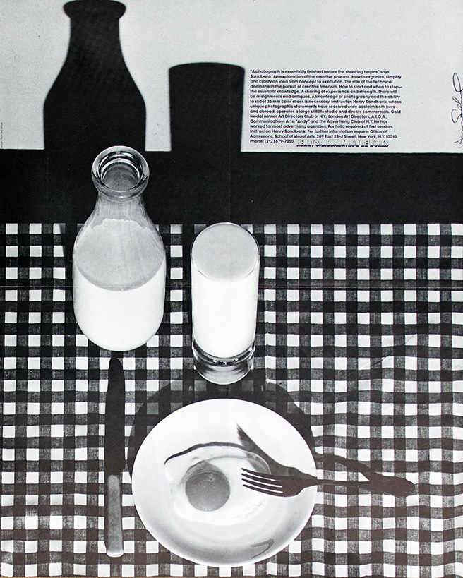 Egg on a plate with carafe and glass of milk on checkered tablecloth.