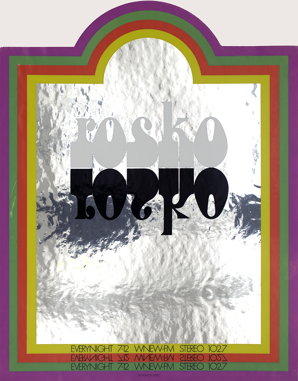 "A rainbow frame around mirrored surface with the name ""rosko"" in white type and black type mirrored underneath"