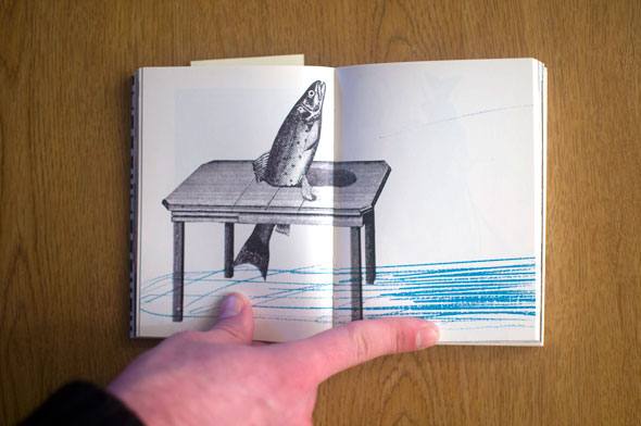 Flipbook opened to show a spread  containing a fish in a table against a white background