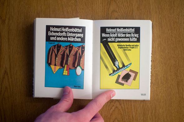 Flipbook opened to show a spread depicting two propaganda posters, left with a rack of brown coats against a blue background and right  with a razor and a depiction of Hitler's mustache