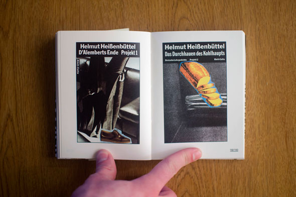 Flipbook opened to show a spread depicting two posters, left with an upside-down men's suit and right with a loaf of bread against a black and white background
