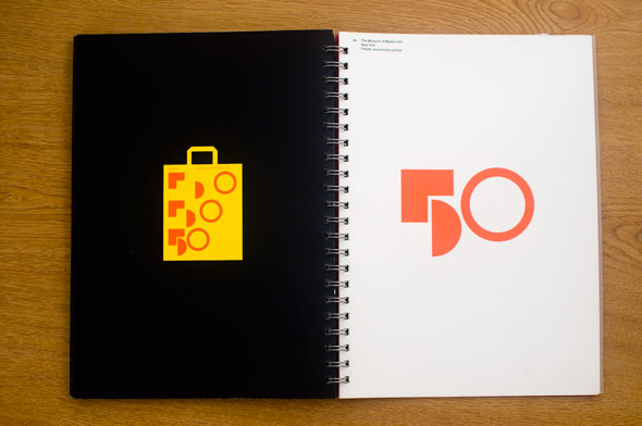 "Spread; right is an orange collection of geometric shapes that form the number ""50"" against a white background; left is a yellow shopping bag with the same logo against a black background"