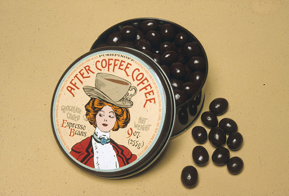 Tin containing espresso beans; lid is an illustration of a redheaded 19th century woman with a coffee cup shaped hat