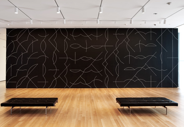 MOMA exhibit of a large, geometric white on black mural.