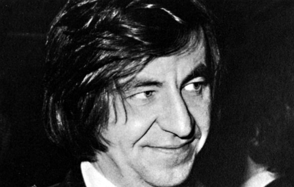 Black and white photograph of a man with medium-length hair
