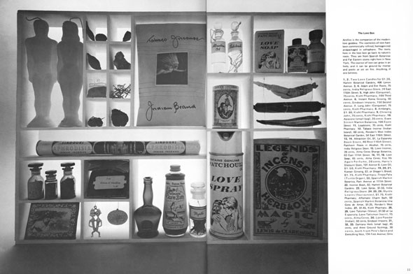 "Black and white photograph of objects stored in a grid, including male and female shaped candles, a ""Love Spray"" perfume, and jars of liquid."