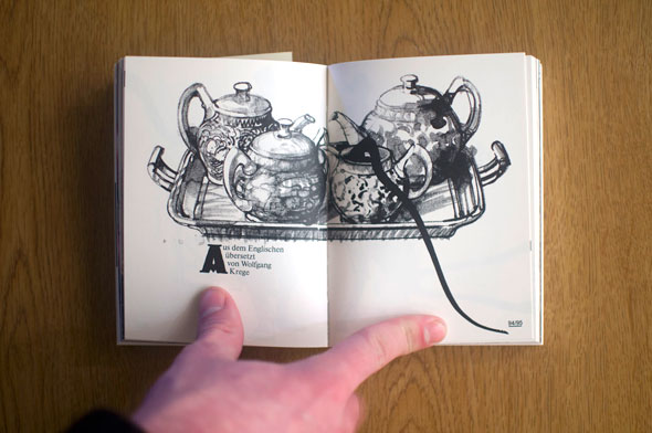 Flipbook opened to show a spread depicting a black and white illustration of four teapots on a tray