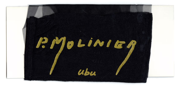 A photo of Black silk stocking wrapped around card; P. Molinier and ubu are written on top in gold