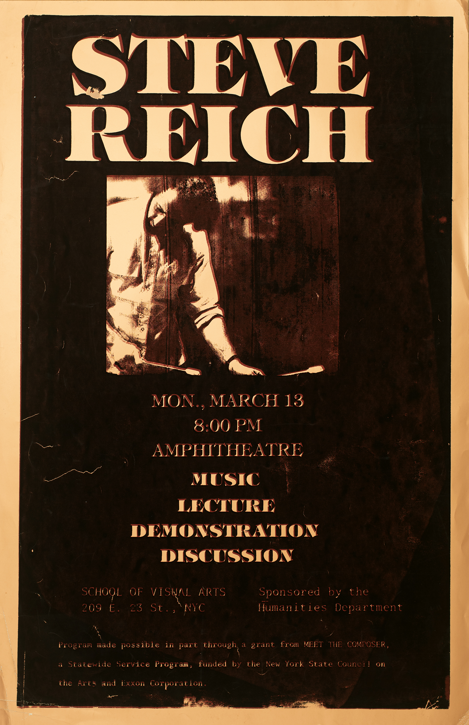 "A black poster with a small square sepia photo in the middle of a bearded man with two drum mallets. Above the picture in big white text reads ""Steve Reich"" below in a smaller font is location and date."