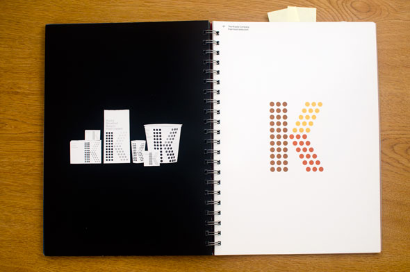 Spread; right is a colorful letter K made up of a brown, yellow, and red dot grid against a white background; left is a series of objects such as boxes and cups with the logo against a black background