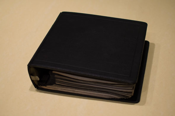 Color photograph of a black binder on a table