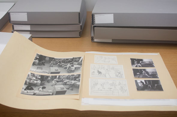 A photo of a folder wide open. Inside on the left are 2 monochrome printed pictures. Next to it are drawings of the printed picture on a small paper. On the right are 3 smaller printed pictures of a person.
