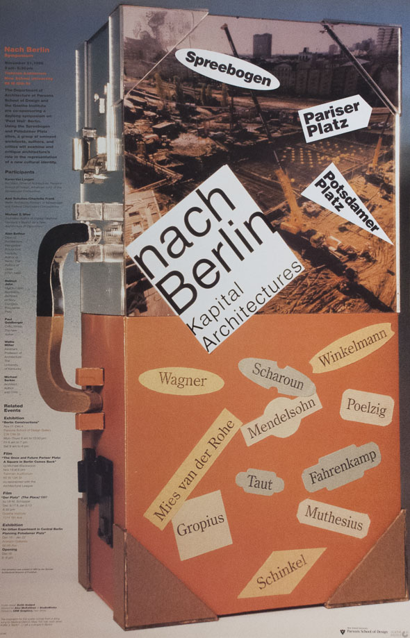 An orange metal case with a cover including an image of Berlin, Germany, and stickers of various german language text.