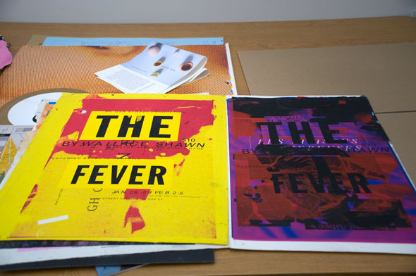 "A photo of two posters for ""The fever"". The one on the left is a bright yellow with a scarlet red print covering some of the background. The title is in big thick bold black letters. The poster on the right has the same font style but the background is a deep purple with muddy red splatter prints scatter around. A hand reaching out is barely readable on the cover covered by the red splatters."