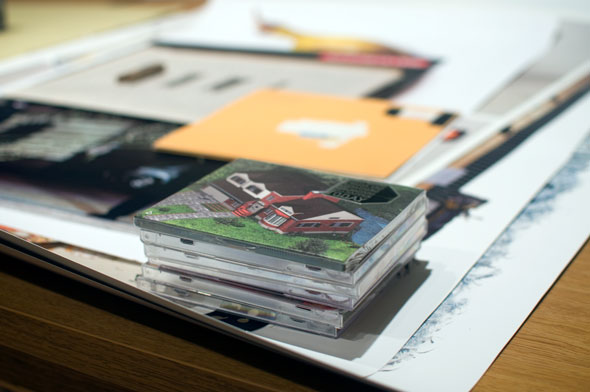 Stack of CDs, among other materials in the archives