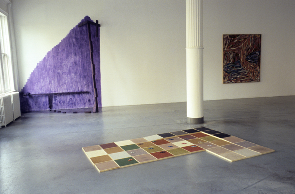 Color photograph of Tribeca gallery's first show; wall installation, floor installation and painting are visible