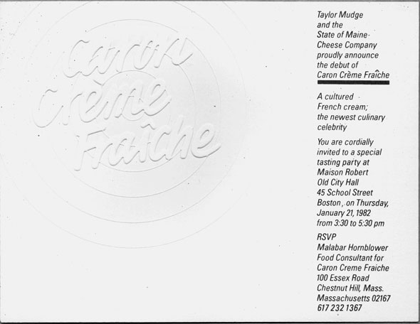 A photo of a White card with a single column of black text down the right side; rest of space is taken up by embossed circular logo with the words Caron Crème Fraîche on top of a target.