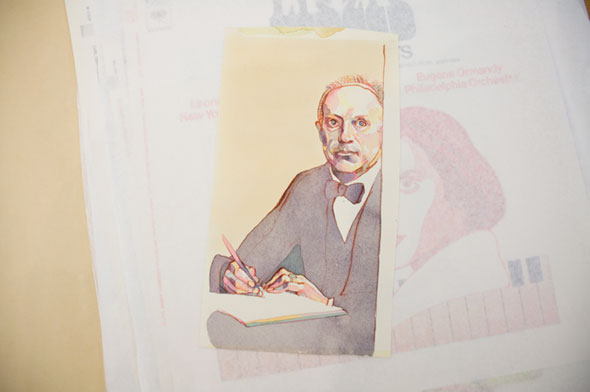 A photo of a watercolor illustration. A man wearing a black and white suite and black bowtie is sitting while writing on a book. The man's skin is not only a plain beige, but also has hints of green, yellow, pink, and blue.
