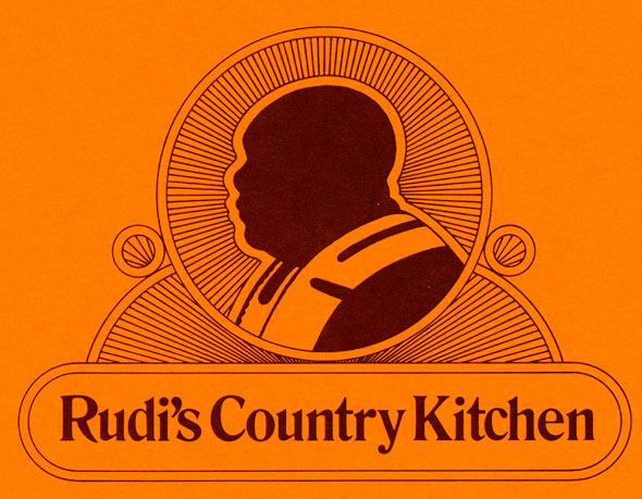 "A brunt orange menu. In the middle is a dark brown silhouette of a black bald man in a pastor like clothing. The silhouette is in circle that has lines going inward towards the silhouette, giving is a holy-like glow. Underneath is ""Rudi's Country Kitchen"" in a dark dark formal lettering. The text is within a minimalistic boarder."
