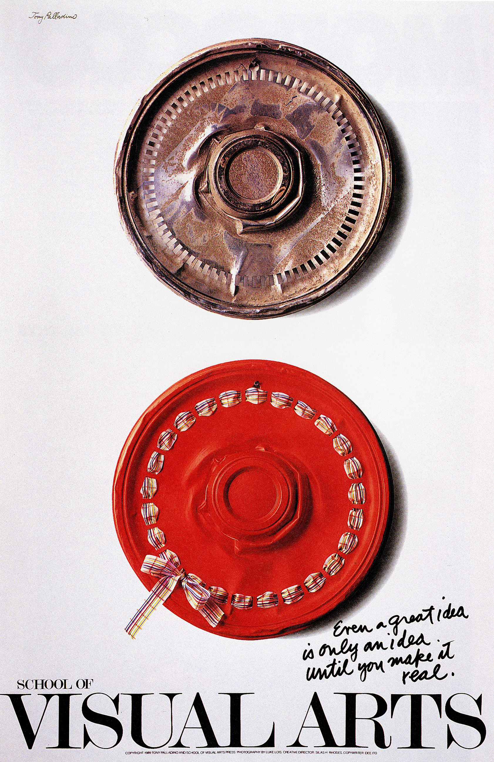Photograph of two hubcaps against a white background, presented vertically; top one is rusted, while the bottom one is painted red with a ribbon and bow threaded through it.
