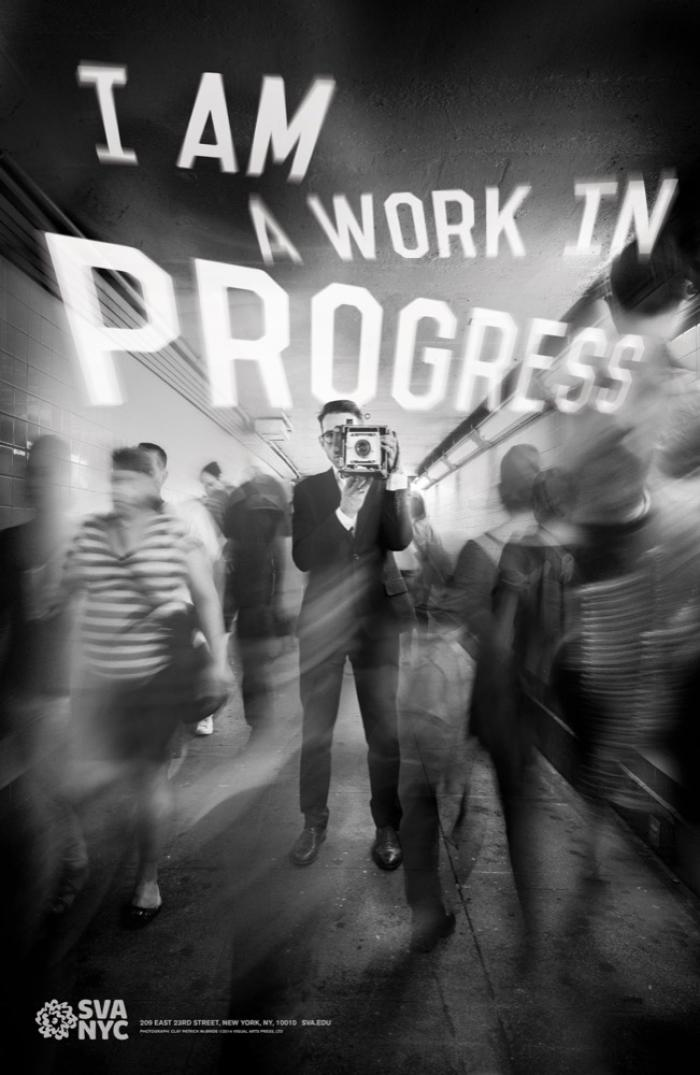 Blurred black and white photograph of a man in a suit taking a picture of the viewer surrounded by a fast-moving crowd in the subway. Text appears above the crowd in white.